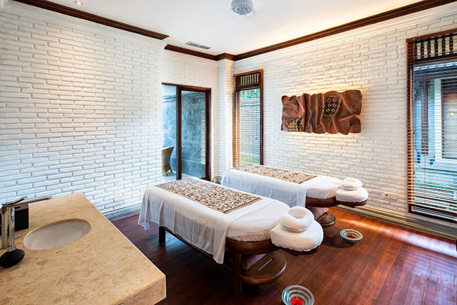 Ironwood decks the floor of each new villa's spa treatment room, nestled between the indoor living space and outdoor bathing area.